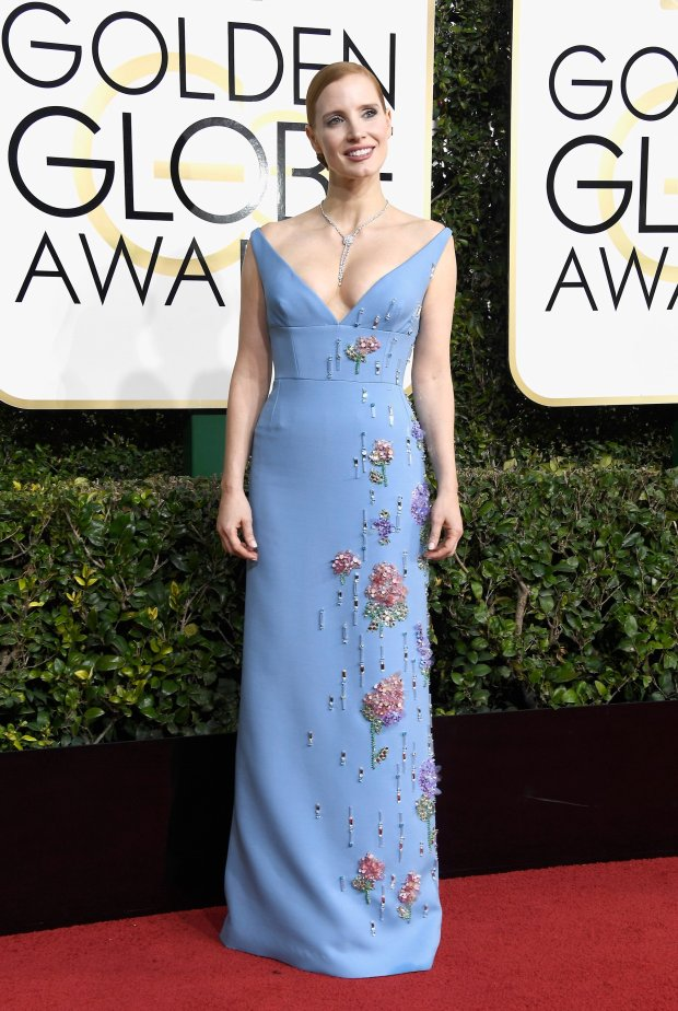 The night of black and low, v-cuts takes a back seat to this choice by Jessica Chastain, from the unique color and elegant line to just the right amount of shimmer, at the Golden Globe Awards on January 8, 2017 in Beverly Hills, California. (Photo by Frazer Harrison/Getty Images)